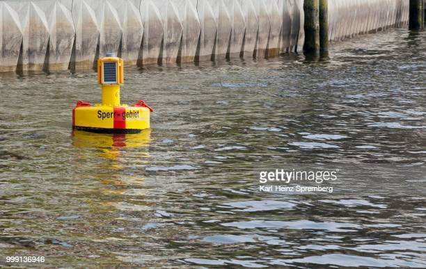 yellow buoy in the harbour basin of hamburg, hamburg, germany - captions stock photos and pictures