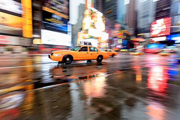 Yellow cab and reflections, Times Square, New York
