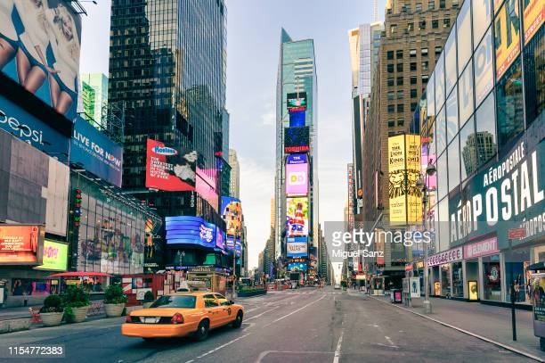 yellow cab in times square, manhattan, new york - times square manhattan stock pictures, royalty-free photos & images