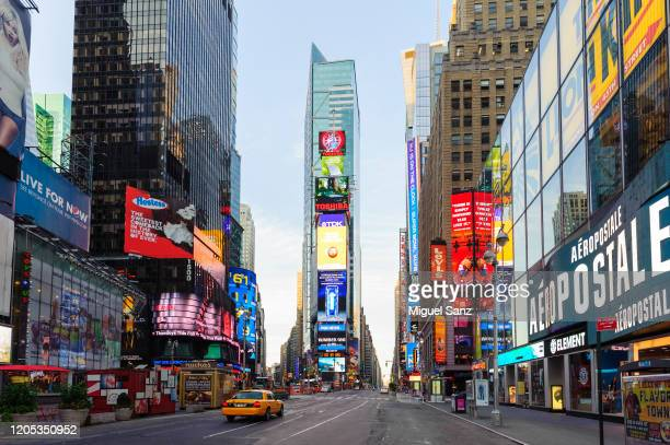 yellow cab in times square manhattan, new york - times square manhattan stock pictures, royalty-free photos & images