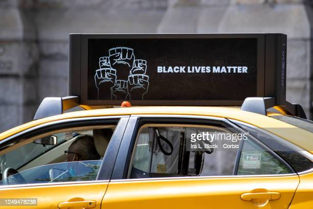 Yellow Cab New York City Taxi has a digital sign on its roof that reads Black Lives Matter' with multiple black power fists in a circle as it drives...