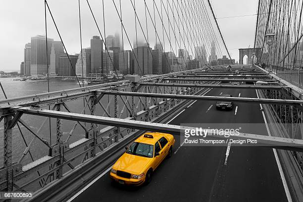 Yellow cab on Brooklyn bridge