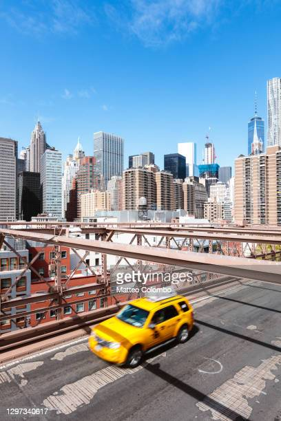 yellow cab passing on brooklyn bridge, new york, usa - brooklyn new york stock pictures, royalty-free photos & images
