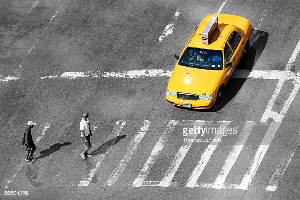 Yellow cab stopping at the crosswalk New York City USA