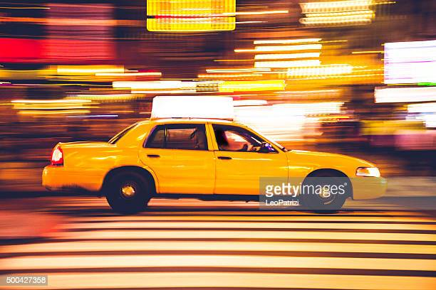 yellow cab traffic in times square - taxi stock pictures, royalty-free photos & images