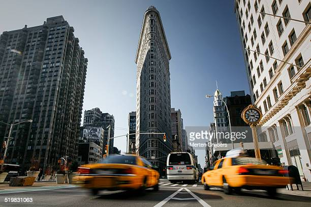 Yellow cabs below Flatiron building