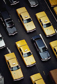 Yellow cabs mingle with other cars in heavy traffic on manhattans picture id596964574?s=170x170