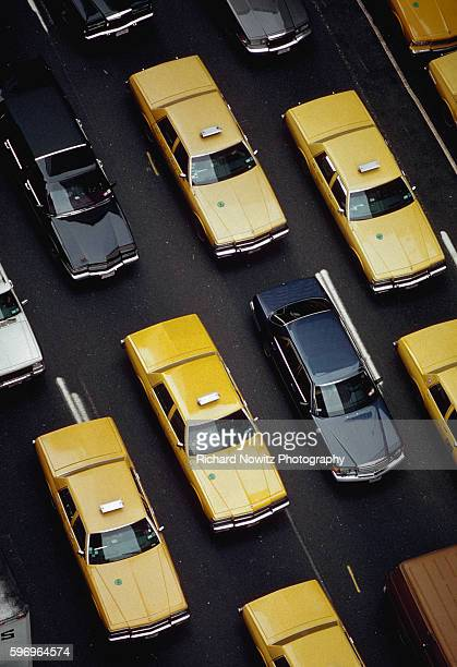 Yellow cabs mingle with other cars in heavy traffic on Manhattan's Sixth Avenue