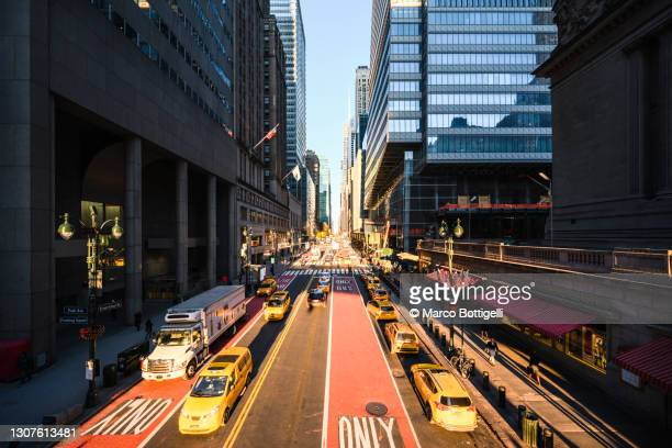 yellow cabs on 42nd street, new york city - manhattan new york city stock pictures, royalty-free photos & images