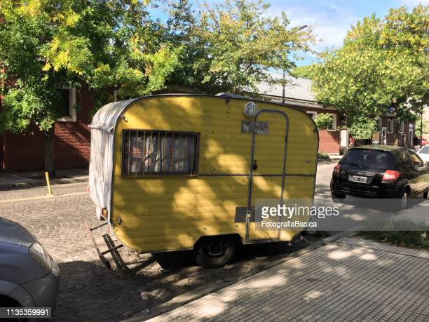 Yellow camper trailer in the street