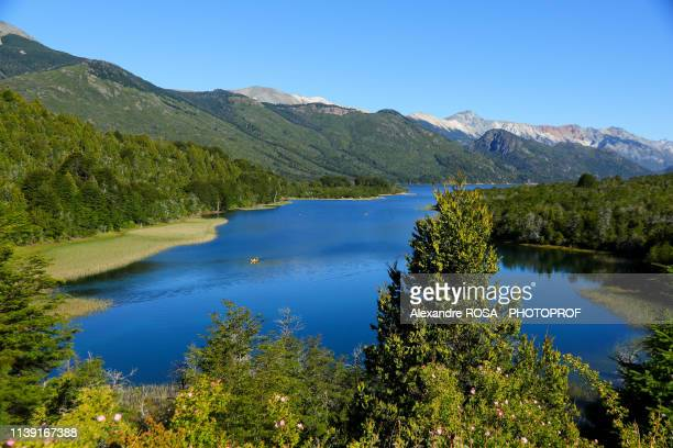 yellow canoe on the blue waters of mascardi lake south of san carlos de bariloche in patagonia, argentina - bariloche stock pictures, royalty-free photos & images
