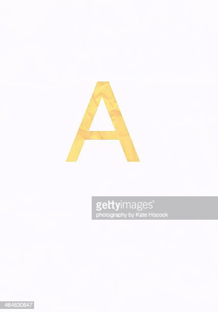 yellow capital letter A - paper cut
