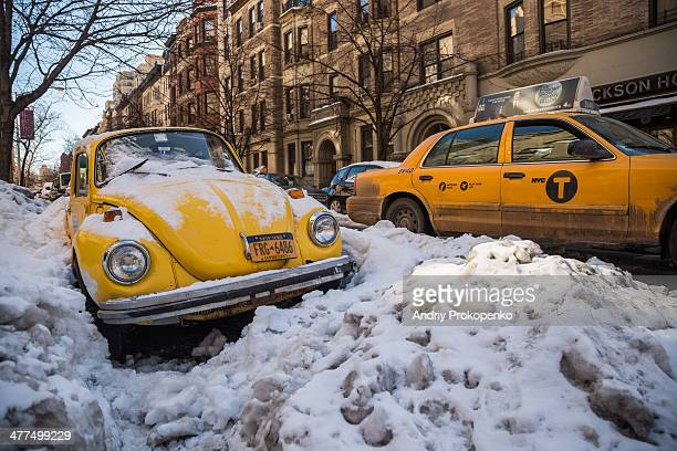 CONTENT] Yellow car caught in a snow trap on the Upper West Side New York after a massive snowstorm