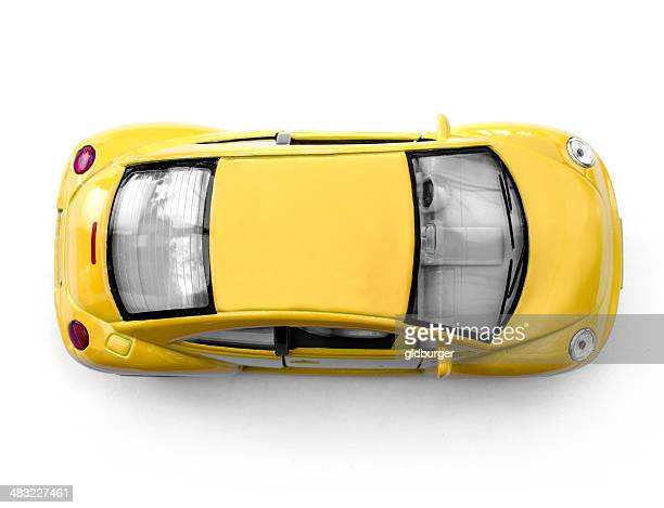 yellow car from above - volkswagen beetle stock photos and pictures