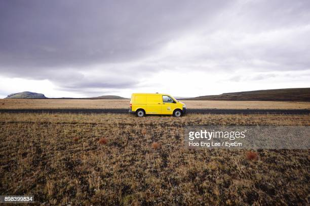 Yellow Car On Field Against Sky
