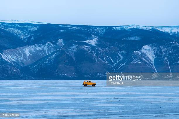 A yellow car on the frozen Baikal lake