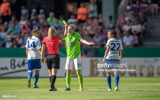 Yellow card followed by a red card for Forward Alexandra Popp of VFL Wolfsburg because of moning during the Women's DFB Cup Final 2017 between SC...