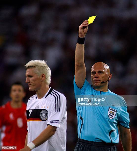 Yellow card for Bastian Schweinsteiger of Germany from referee Tom Henning Ovrebo during the UEFA EURO 2008 Group B match between Germany and Poland...