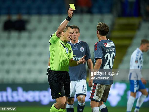 Yellow card for Elmar Bjarnason of AGF Arhus from referee Michael Tykgaard during the Danish Alka Superliga match between OB Odense and AGF Arhus at...