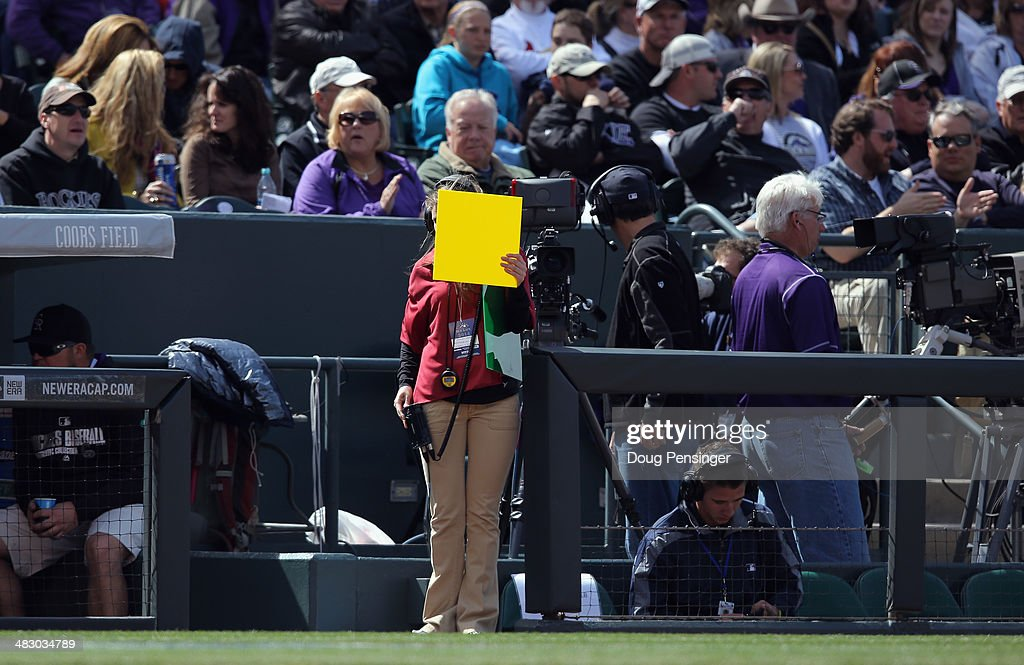 A yellow card is displayed on the field as the Arizona Diamondbacks face the Colorado Rockies during the home opener at Coors Field on April 4, 2014 in Denver, Colorado. The Rockies defeated the Diamondbacks 12-2.