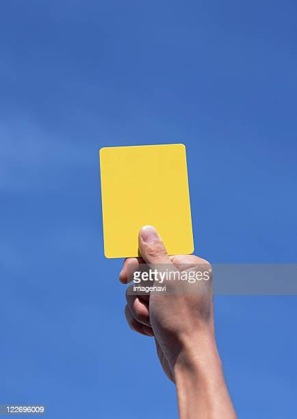 yellow card - yellow card sport symbol stock pictures, royalty-free photos & images