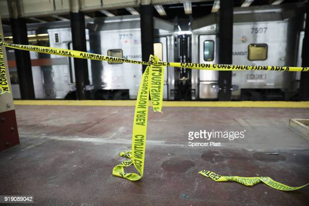 Yellow caution tape blocks off an area under construction at New York's Pennsylvania Station on February 16 2018 in New York City Amtrak gave a media...
