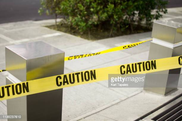 yellow caution tape line - cordon tape stock pictures, royalty-free photos & images