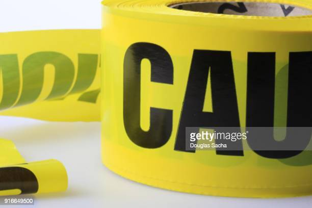 yellow caution tape - flag texture stock photos and pictures