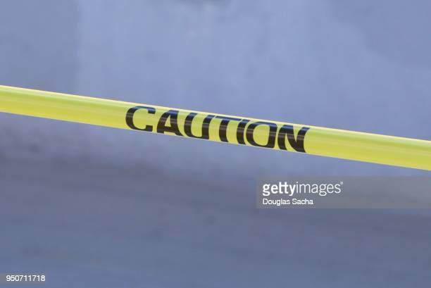 yellow caution tape - cordon boundary stock pictures, royalty-free photos & images