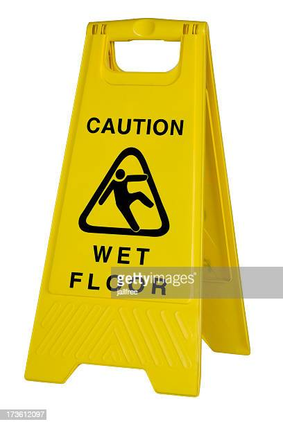 Yellow caution wet floor sign on white background