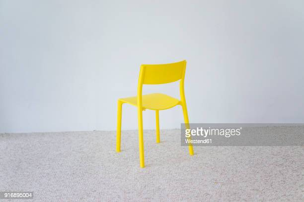 yellow chair - chair stock pictures, royalty-free photos & images