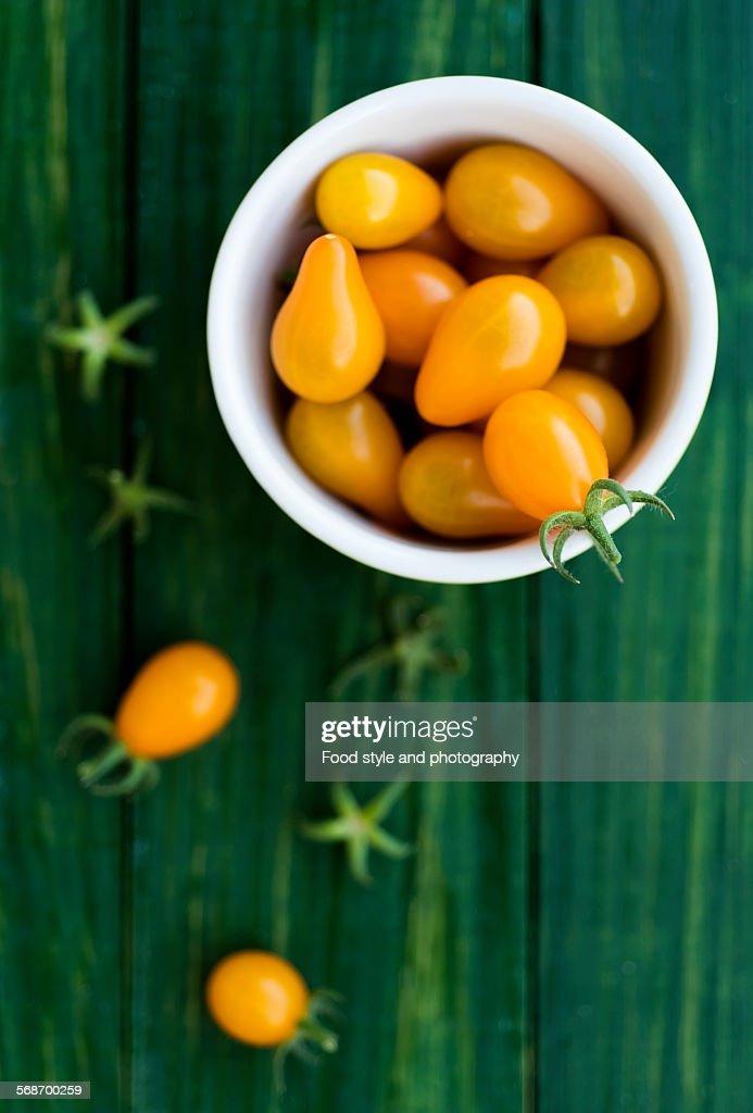 Yellow cherry tomatoes : Stock Photo