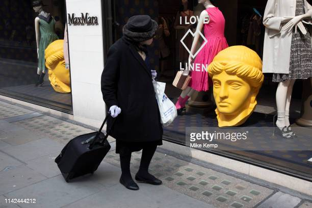 Yellow classical heads in exclusive clothes shop window for Max Mara on New Bond Street in Mayfair London England United Kingdom Bond Street is one...