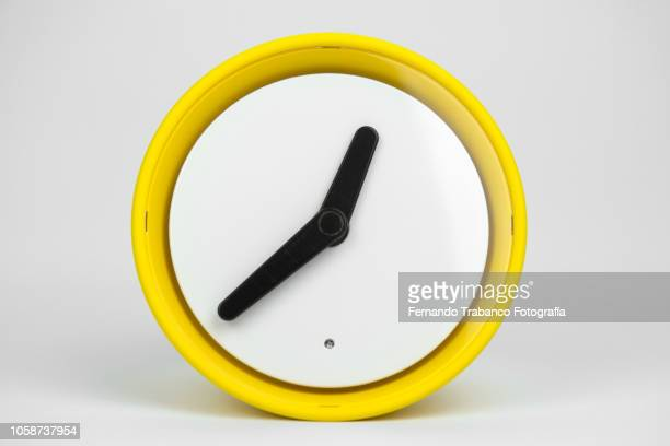 yellow clock - countdown clock stock-fotos und bilder