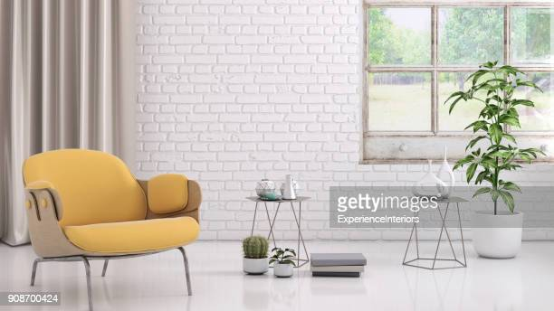 Yellow colored armchair with coffee table, flowers and blank wall template