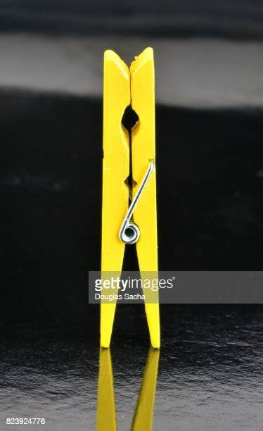 Yellow colored Spring-type clothespin