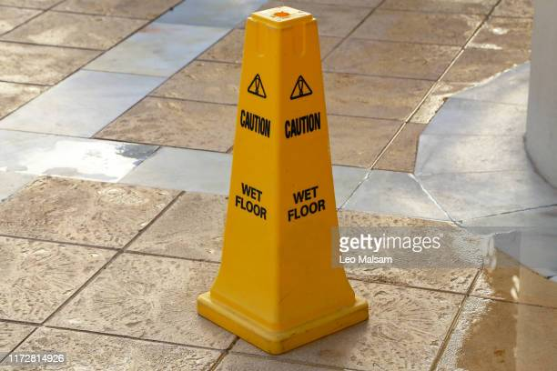 yellow column near pool warns danger