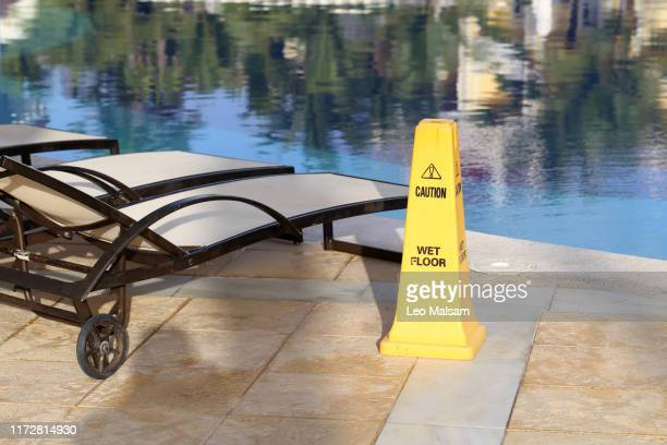 yellow column near pool warns danger
