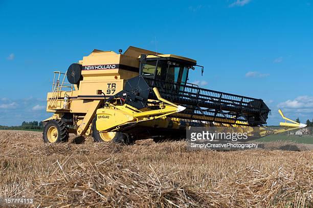 Yellow Combine in Wheat Field