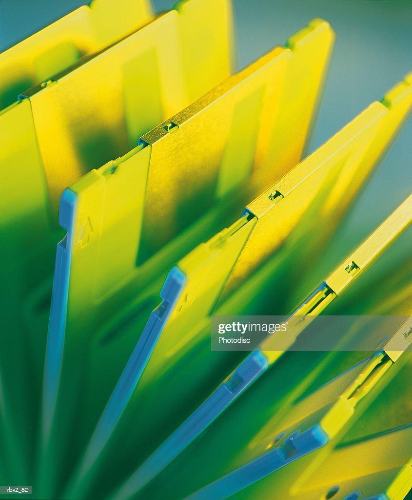 yellow computer disks created green shadows as the reflect light : Foto de stock