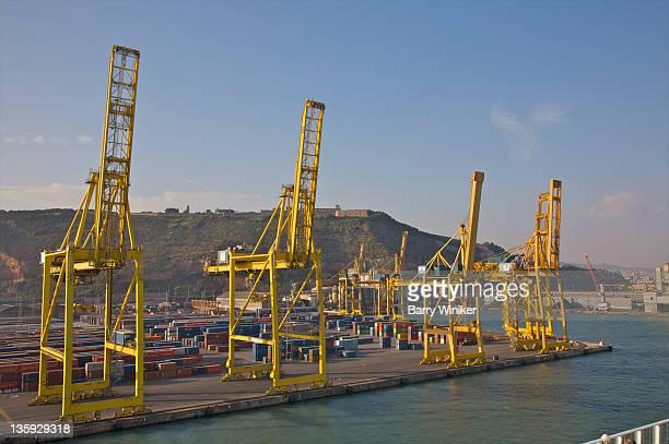 yellow container cranes at edge of port. - barry crane stock-fotos und bilder