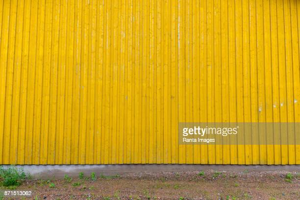 yellow corrugated wall of metal - corrugated iron stock photos and pictures