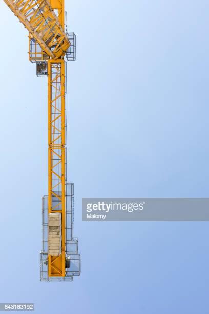 Yellow crane in blue sky - Munich, bavaria, Germany