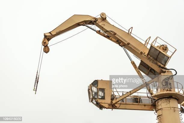 yellow crane on a production platform - cavo d'acciaio foto e immagini stock