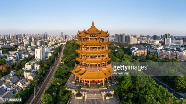 yellow crane tower at dusk - wuhan stock pictures, royalty-free photos & images