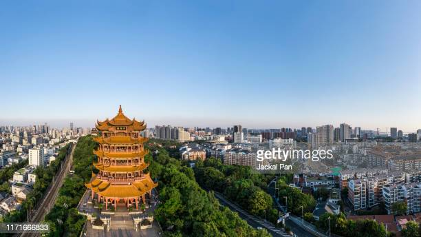 yellow crane tower at dusk - wuhan stock photos and pictures