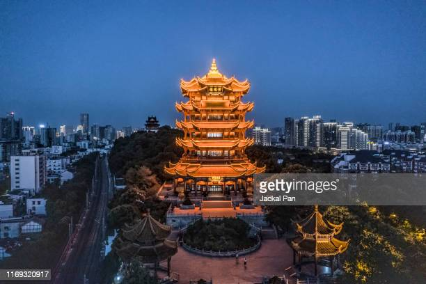 yellow crane tower at night - wuhan stock pictures, royalty-free photos & images