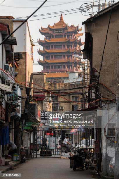 yellow crane tower in the street end - wuhan stock pictures, royalty-free photos & images