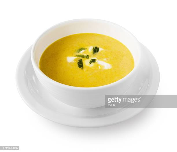 Yellow cream soup with garnish