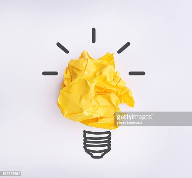 yellow crumpled paper - light bulb stock pictures, royalty-free photos & images